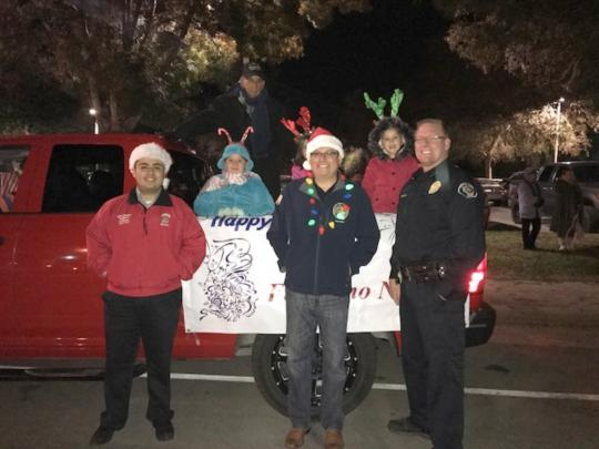 Arvin Christmas Parade - Assemblymember Salas Standing in front of Christmsas float