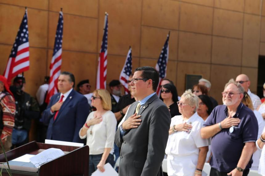 Assemblymember Rudy Salas and Gold Star families recite the pledge of allegiance at the Bakersfield National Cemetery